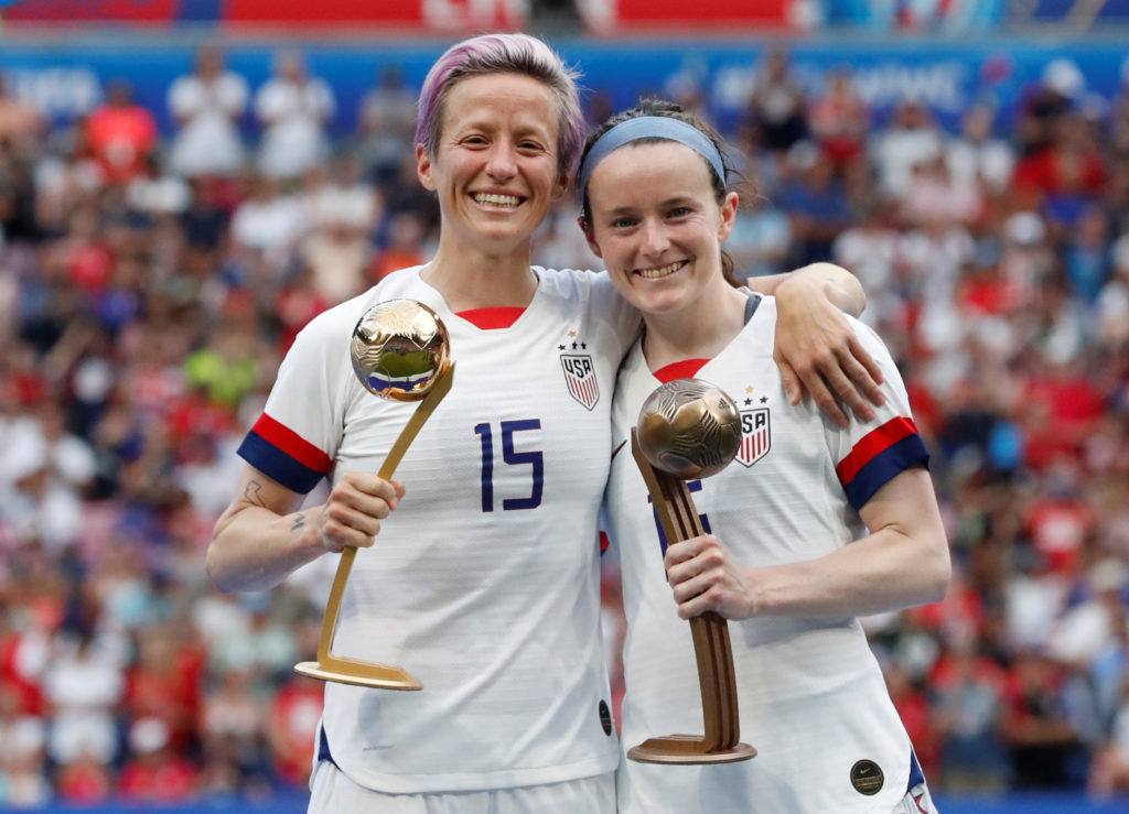 Megan Rapinoe and Rose Lavelle of the U.S. celebrate being awarded the golden ball and bronze ball after winning the FIFA Women's World Cup in Lyon, France, July 7, 2019. Lavelle is a graduate of Mount Notre Dame High School in Reading, Ohio. (CNS photo/Bernadett Szabo, Reuters)